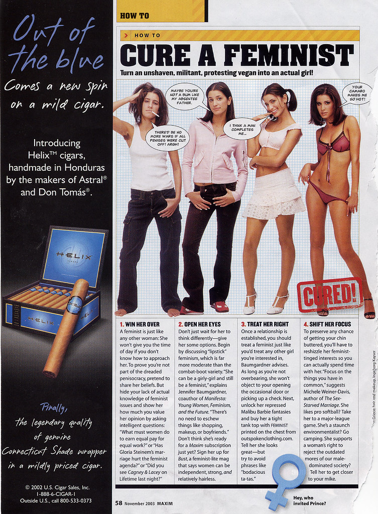 "A page out of Maxim magazine with a cigar ad on the left. The page features four captioned images of the same woman in different states of dress, from fully clothed in jeans and a white tank top to made up and wearing red see-through undergarments, depicting her transformation from a ""feminist"" into a ""real girl."""