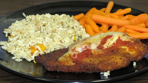 Chicken parmigiana with rice pilaf and carrots by Coyoty