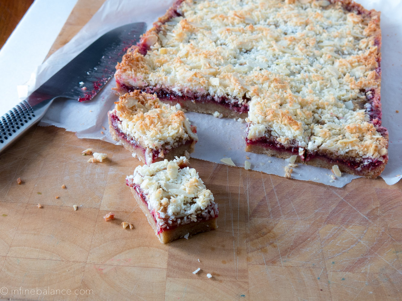 raspberry crumb bars on a cutting board