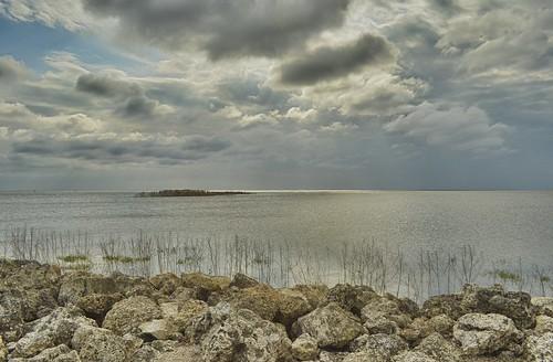 sky lake water weather clouds landscape scenery rocks day cloudy horizon shoreline shore vista okeechobee