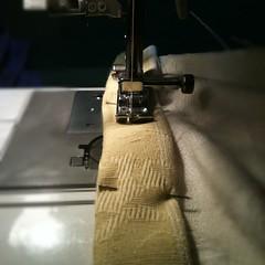 wheel(0.0), sewing(1.0), sewing machine(1.0), art(1.0), iron(1.0),