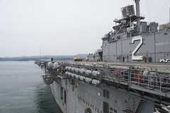 In this file photo, amphibious assault ship USS Essex (LHD 2) departs Sasebo, Japan, April 29 following a successful hull swap between the crews of Essex and USS Bonhomme Richard (LHD 6). (U.S. Navy photo by Senior Chief Mass Communication Specialist Joe Kaned)