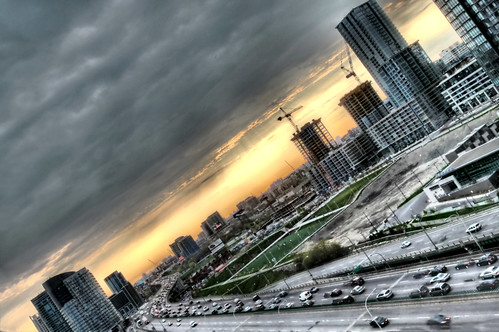 blue sunset sky cloud sun white toronto ontario canada black west green cars grass car yellow clouds canon gold grey highway purple traffic angle crane horizon gray cranes condo highrise gardiner condos hdr buidling hdri buikding photomatix alienskin ef24105l morningdewphotography t1i TGAM:photodesk=urbanscenes