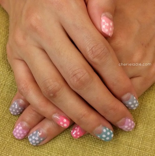 Polka dots on multi-colored pastels and half moons manicure