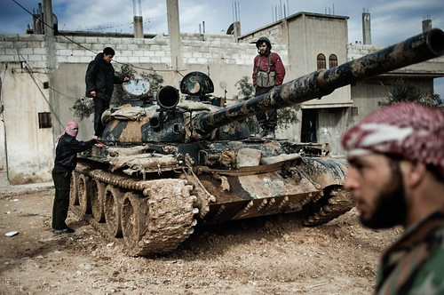 A Free Syrian Army member prepares to fight with a tank