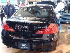 wheel(0.0), rim(0.0), automobile(1.0), automotive exterior(1.0), family car(1.0), vehicle(1.0), automotive design(1.0), sports sedan(1.0), auto show(1.0), mid-size car(1.0), infiniti g(1.0), bumper(1.0), sedan(1.0), infiniti(1.0), land vehicle(1.0), luxury vehicle(1.0),