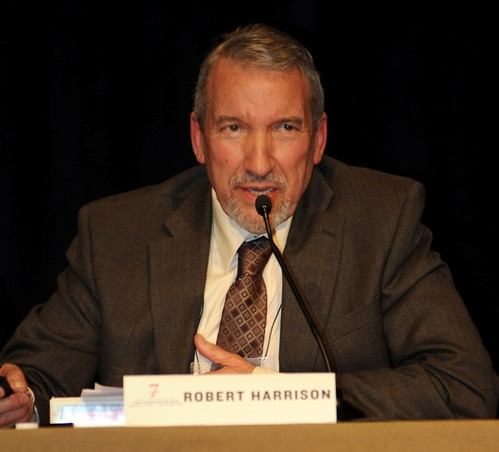 photo of Rob Harrison at panel table