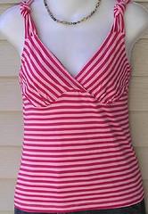 neck(0.0), magenta(0.0), sleeve(0.0), blouse(0.0), shirt(0.0), swimwear(0.0), dress(0.0), t-shirt(0.0), swimsuit top(1.0), clothing(1.0), sleeveless shirt(1.0), maroon(1.0), outerwear(1.0), pink(1.0),