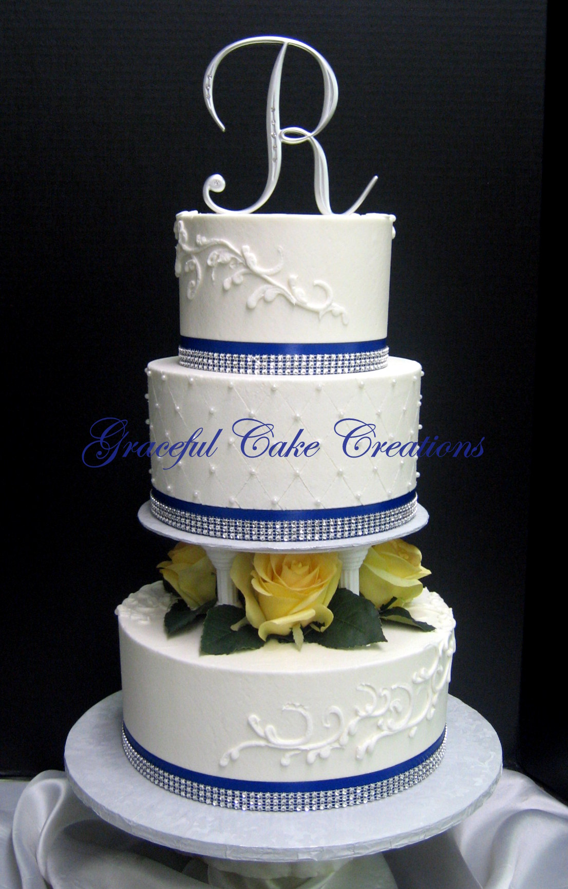 Elegant White Wedding Cake with Yellow Roses Royal Blue