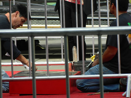 Workers put the final touches after Legendary director/writer/humanitarian Jerry Lewis left his hands and footprints in cement  @ the TCL Chinese Theartre in Hollywood on Saturday April 12, 2014.