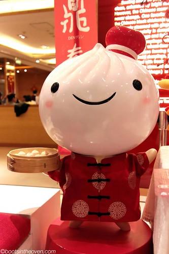 Smiling happy dumpling holding dumplings