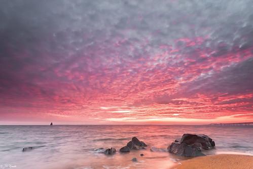 bridge pink winter red orange brown sunlight lighthouse beach water clouds sunrise sand rocks waves horizon maryland boulders shore chesapeakebay thelionsroar