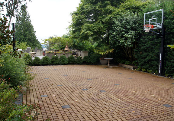 The basketball court is also a parking lot.