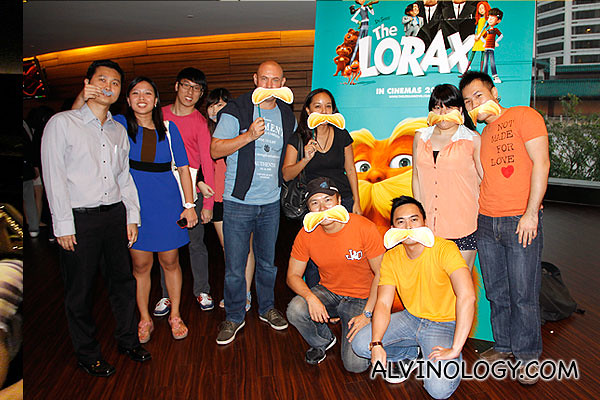 Bloggers dressed in orange and with orange mustaches for The Lorax preview