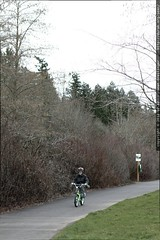 nick circumnavigates a public park on his bicycle   …