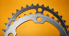 One of these is a chainring, the other one is scrap aluminum.