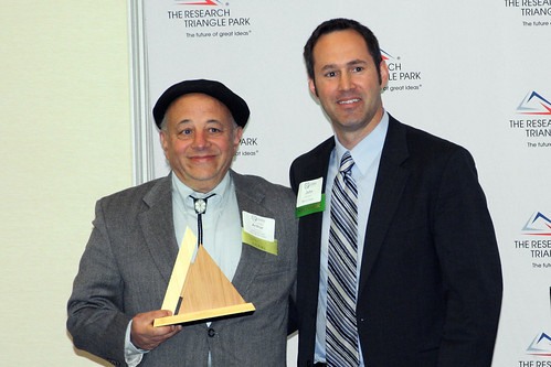 Arthur Gordon, from the Irregardless Cafe & Catering, receives his award from John Kinneer with Wells Fargo.