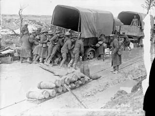 Canadians giving a lorry a helping hand on a shell battered road on Vimy Ridge. April, 1917 / Des Canadiens aidant à déloger un camion sur un chemin troué par les obus sur la Crête de Vimy