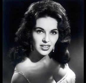 a black and white photograph of a young Wanda Jackson