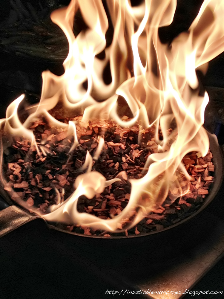 Hickory wood chips, set aflame to later smoke the salmon with.