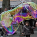 Small photo of Enchanted by a soap bubble flying in Paris