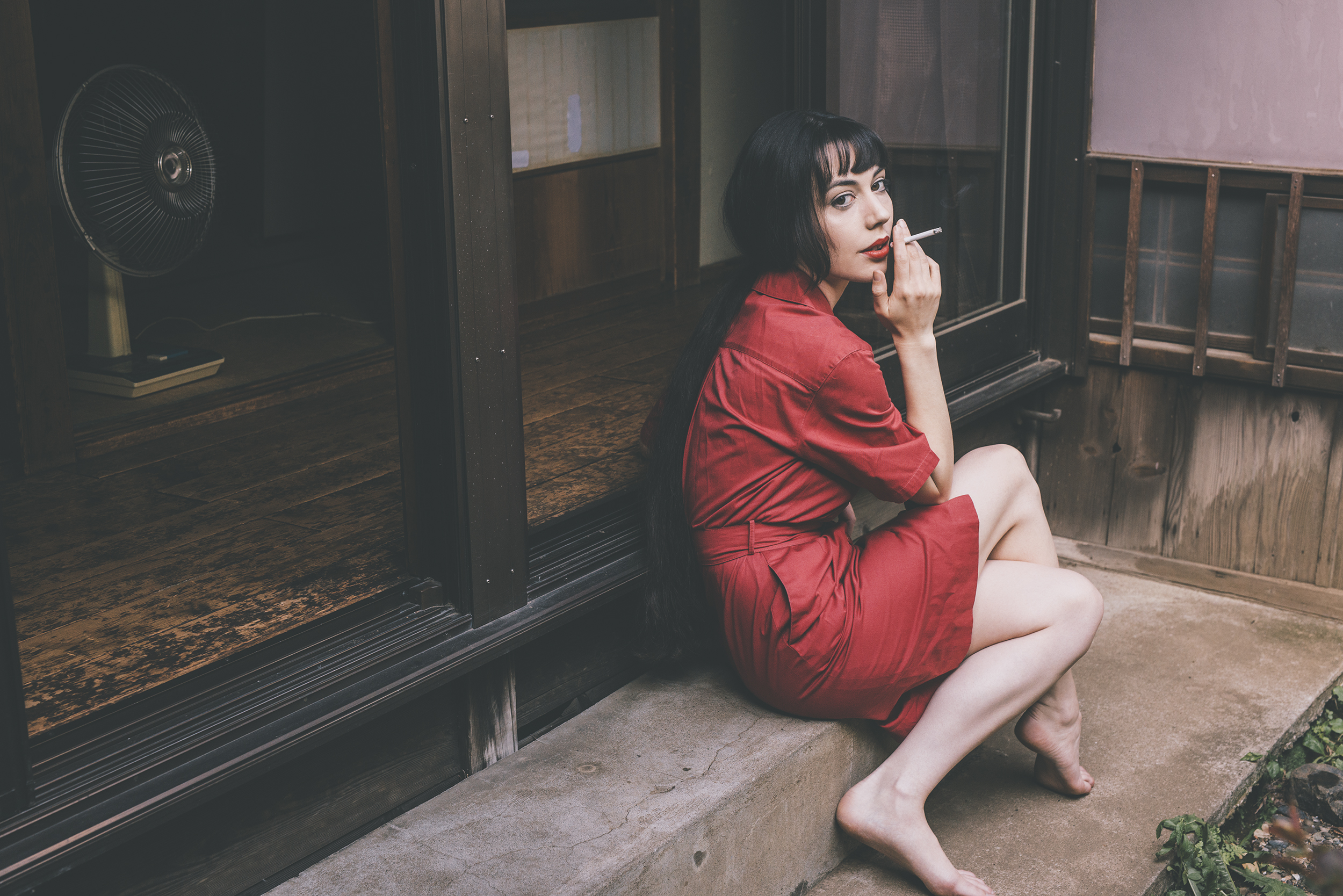 Gestalta photographed by Shuji Kobayashi. Girl in a red dress and red lipstick smoking a cigarette
