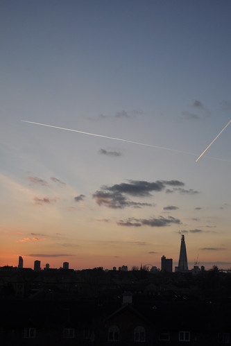 Plane trails over south London sunset