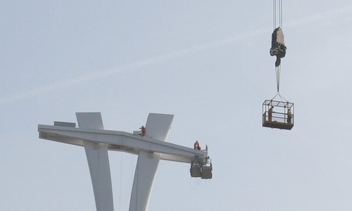 People working on the top of the Cable Car pylon