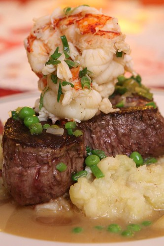 Pan Roated Beef Tenderloin with Lobster Tail, English Peas and Seafood Broth Butter Sauce