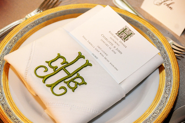 Custom hemstitch napkins on the head table were gifts from the groom 39s