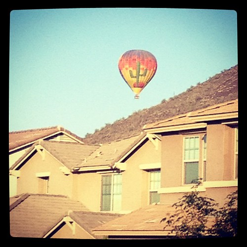 Hot air balloon over the mountains in our neighborhood