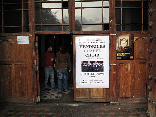 A super-sized poster outside Iglesia de San Francisco in Santiago, Chile advertising Hendricks Chapel Choir's concert
