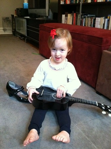 Playing the ABC song on her new guitar
