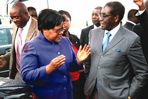 Zimbabwe President Robert Mugabe being greeted by Vice President Joice Mujuru upon his arrival from Singapore for an annual holiday. Mugabe is the leader of the ZANU-PF ruling party in this Southern African state. by Pan-African News Wire File Photos