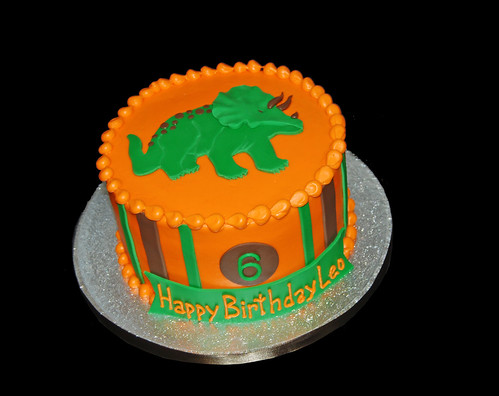 orange brown and green triceratops 6th birthday cake