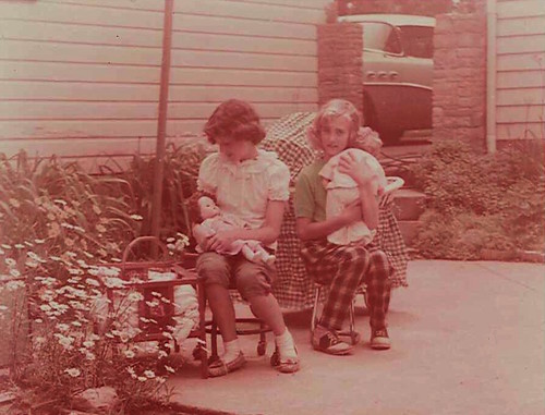 1957-June 24-Sharon and friend Barbara Bencini play with their dollies