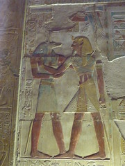 Pharaoh embarced by Anubis