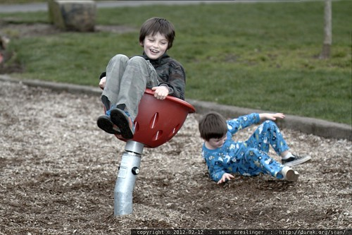 brothers discover centrifugal forces on the playground    MG 8611