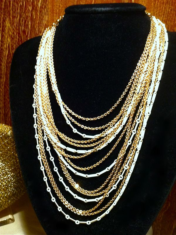Stunning and dramatic multi-strand 1960s neck-piece. Signed Monet.