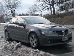 coupã©(0.0), automobile(1.0), automotive exterior(1.0), executive car(1.0), family car(1.0), wheel(1.0), vehicle(1.0), rim(1.0), bumper(1.0), pontiac g8(1.0), sedan(1.0), land vehicle(1.0), luxury vehicle(1.0), sports car(1.0),