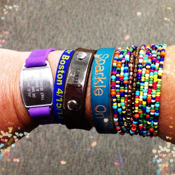 Quite the arm party going on today. @GoSportID Inspire Bracelet & One Fund Boston  Band, @endorphinwarrior bracelet, a Disney bracelet, and some color! #runforboston #runchat #armparty