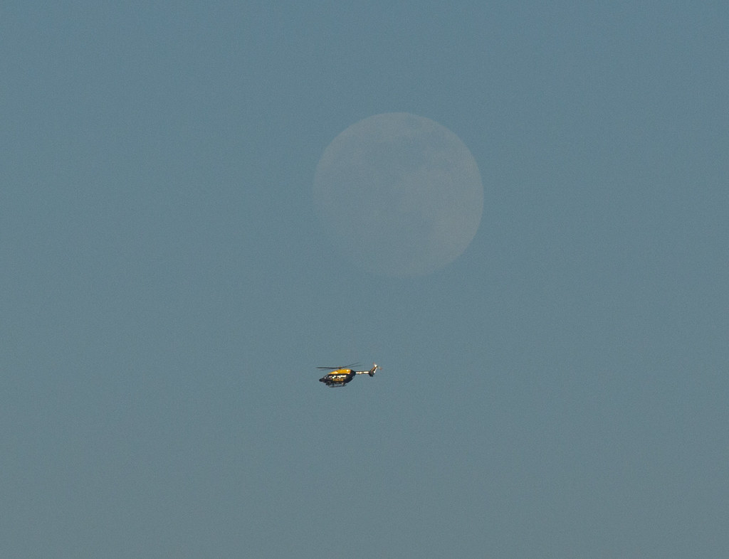 Police Helicopter flying by the Rising Moon 13 April 2014 | Flickr