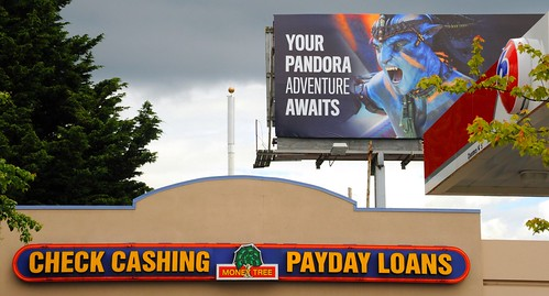 The Nature of Reality - desire: YOUR PANDORA ADVENTURE AWAITS, 76 Station billboard, CHECK CASHING, MONEY TREE, PAYDAY LOANS, Greenwood, Seattle, Washington, USA by Wonderlane