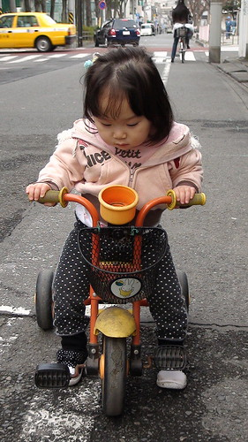 Miyu with her tricycle