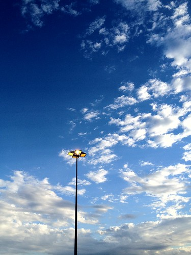 Light post, blue skies and clouds by _camilo