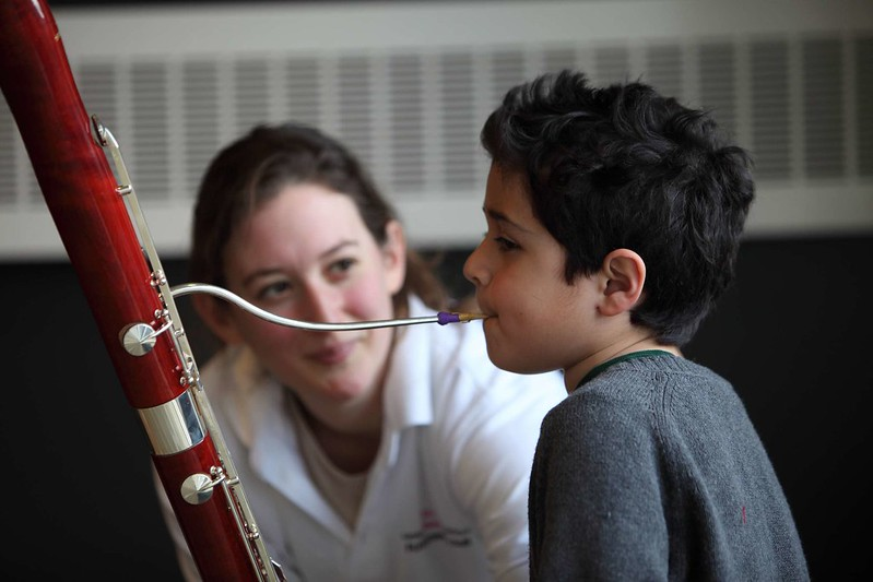 Young child playing bassoon