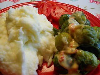 Ultra-creamy mashed potatoes; Brussells sprouts with cheese sauce; Fresh tomato