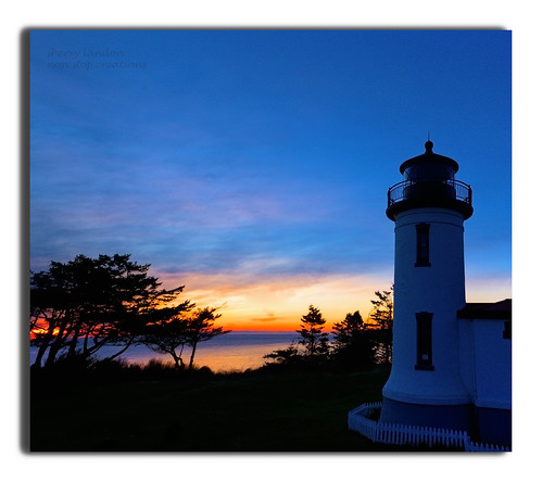 blue sunset lighthouse sillouette