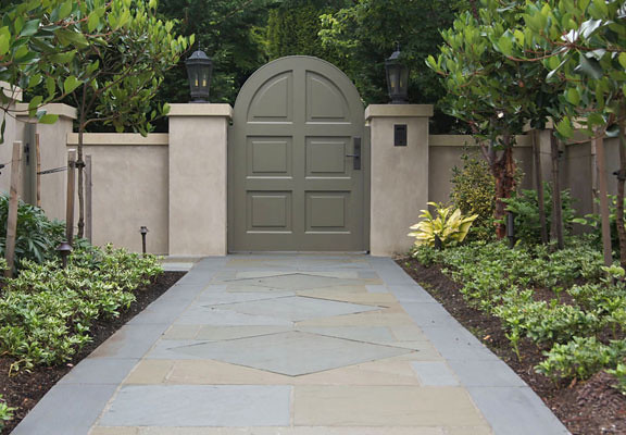 We designed a formal path of  hand-laid variegated bluestone.