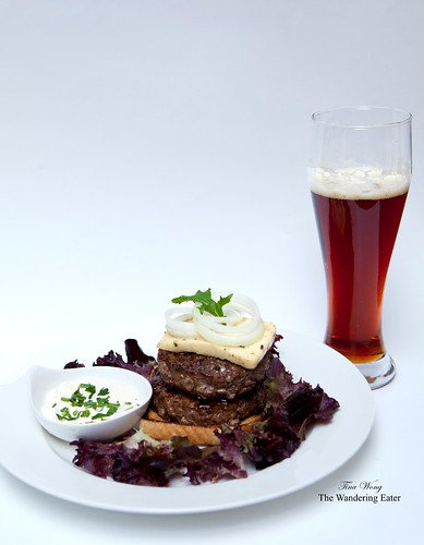 Double lamb burger with black olive cheese , onions and a side of parsley-yogurt sauce
